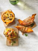 Stuffed pumpkins and potatoes on wooden boards