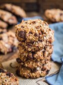 Vegan chocolate chip oatmeal cookies arranged in a pile