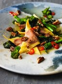 Beetroot ravioli with chillies, scamorza, broccoli rabe and pecan nuts