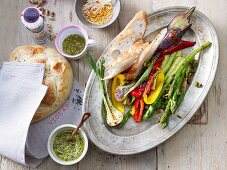 A vegetable platter with broccoli, peppers, aubergines, garlic and various spices