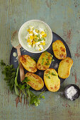Oven-baked potatoes with chopped eggs and wild herbs