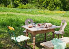 Brotzeit served on a rustic table in a garden