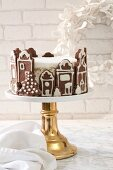 Layered cake in a gingerbread house for Christmas