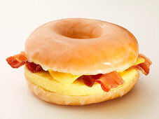 Egg, bacon and cheese in a glazed bagel