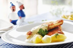 Fried fish with tartar sauce and boiled potatoes