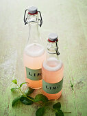 Bottles of rhubarb lemonade with mint