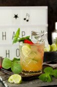A chilli and pineapple cocktail with mint and lime