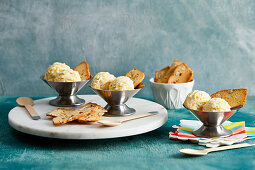 Mandarin ice cream with almond biscuits