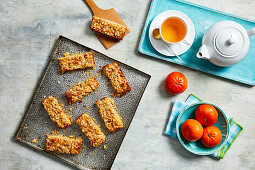 Mandarin and oat bars with a cup of tea