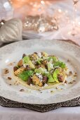 Cauliflower and brussel sprout leaves on a bed of mashed potato, caraway and goat's cheese