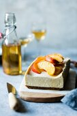 Gluten-free cheesecake with peaches in elderflower syrup
