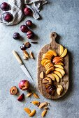 Peach, nectarine and plum wedges on a wooden chopping board