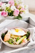 Miso yum yum with brown rice, salmon, vegetables and a fried egg