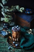 Chocolate dessert with blueberries and blue sugar pearls