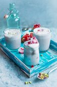Smoothies with pomegranate seeds and pistachios