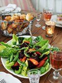 Romaine lettuce with carrots, beetroot, sugar snap peas and croissants