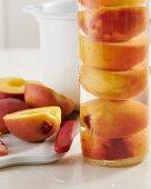 Peaches preserved in a glass