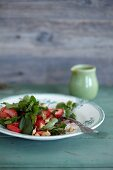 Stinging nettle salad with strawberries