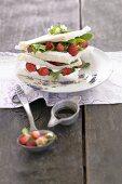 Tramezzini with wild strawberries and wild herbs