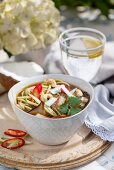 Noodle soup with mushrooms, chilies and cashew nuts (Asia)