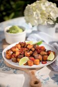 Fried potatoes with chillies and limes