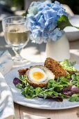 Scotch eggs with salad