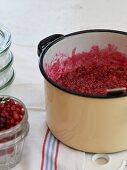 Lingonberry jam in a saucepan