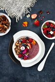 An acai smoothie bowl topped with granola
