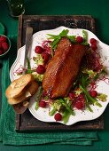 Goose breast with a red cabbage sprout and mange tout salad and raspberries