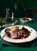 Roast venison in a winter spice and balsamic marinade with bean purée and beetroot
