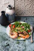 Fried prawns and rocket salad
