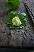 Grated wasabi on a wasabi leaf