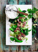 Steak with cashews nam jim and asian greens