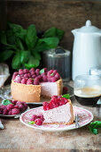 A slice of raspberry cheesecake on a plate