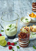 Various creamy desserts and a mixer
