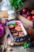 Baked plums with amaretti cookies