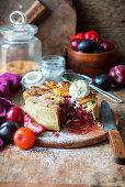 Plum pie with vanilla ice cream, sliced