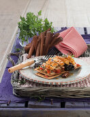 Chicken breast in puff pastry with dried plums, cinnamon and pine nuts (Spain)