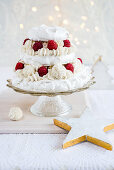 A pavlova with coconut pralines and raspberries for Christmas (third layer)