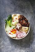 A lunch bowl with Korean bulgogi, vegetables, rice and fried egg (Korea)