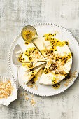 Coconut cheesecake with lime and passionfruit sauce