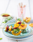 Peach skewers with goat's cheese balls and beetroot