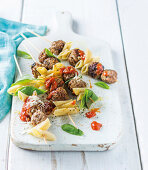 Skewers with meatballs, pasta and tomato sauce
