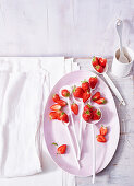 A strawberry still life with a white porcelain plate