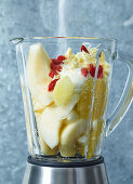 Ingredients for pear and chocolate cream in a blender