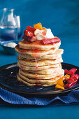 Orange and buttermilk pancakes with poached rhubarb