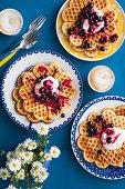 Oat breakfast waffles with blueberry elderflower compote