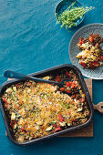 Lentil gratin with peppers and a cheese and breadcrumb crust
