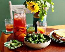 Orange and Pomegranate Sangria and Pimientos de Padron