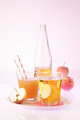 An arrangement of fruit juices (apple juice, and pear and orange juice)